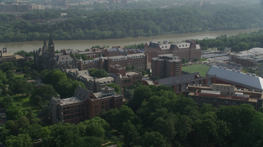 5K stock footage aerial video flying by the Georgetown University Campus in Washington DC Aerial Stock Footage | AX75_117