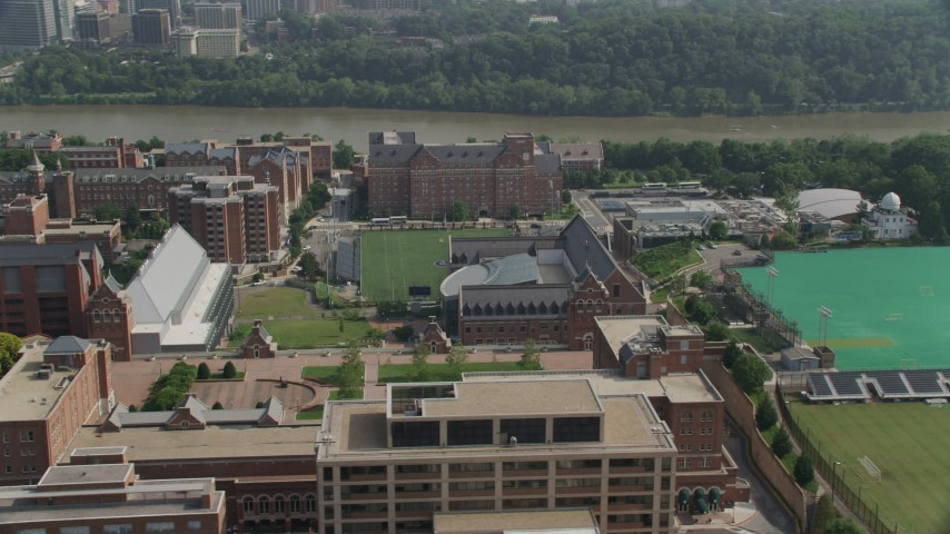 5K stock footage aerial video of riverfront campus of Georgetown University, and sports fields in Washington DC Aerial Stock Footage | AX75_118