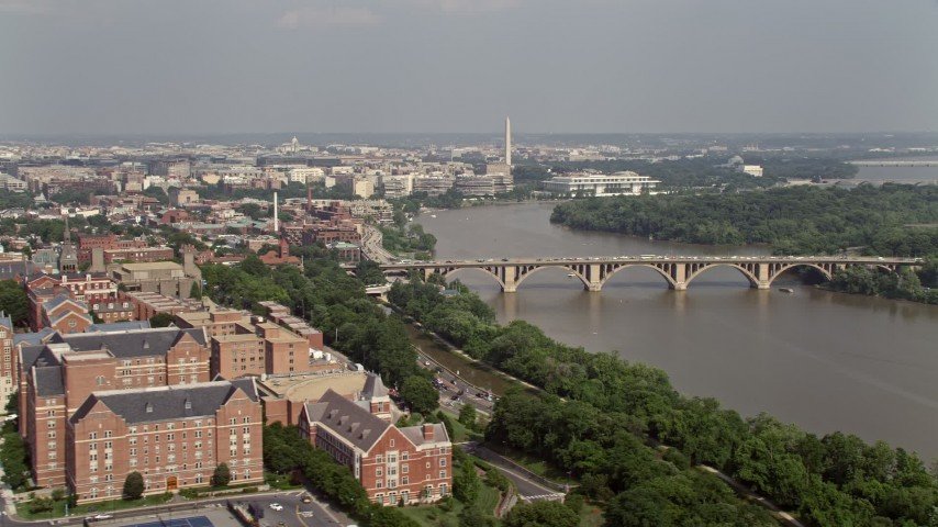 5K stock footage aerial video of Washington Monument, Francis Scott Key Bridge, and Potomac River seen from Georgetown University in Washington DC Aerial Stock Footage   AX75_120E