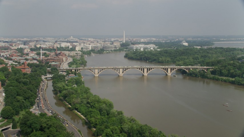 5K stock footage aerial video of Francis Scott Key Bridge over the Potomac River, Washington Monument in background in Washington DC Aerial Stock Footage | AX75_121
