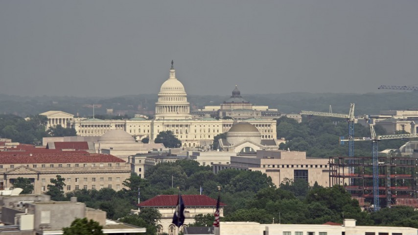 5K stock footage aerial video of the United States Capitol and Smithsonian Museum domes seen from Potomac River in Washington DC Aerial Stock Footage | AX75_124