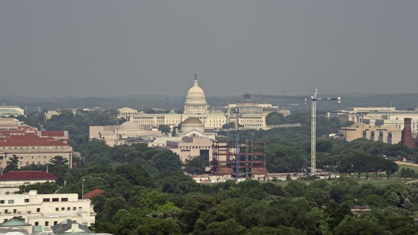 5K stock footage aerial video of the United States Capitol, revealing Washington Monument and National Mall in Washington DC Aerial Stock Footage | AX75_125