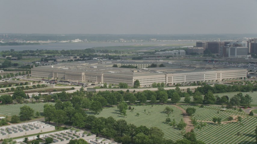5K aerial video of The Pentagon seen while flying over Arlington National Cemetery in Washington DC Aerial Stock Footage | AX75_127