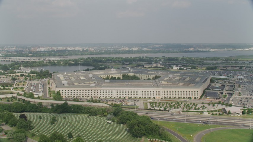5K stock footage aerial video orbiting The Pentagon in Washington DC, with bridges over the Potomac in the background Aerial Stock Footage | AX75_128
