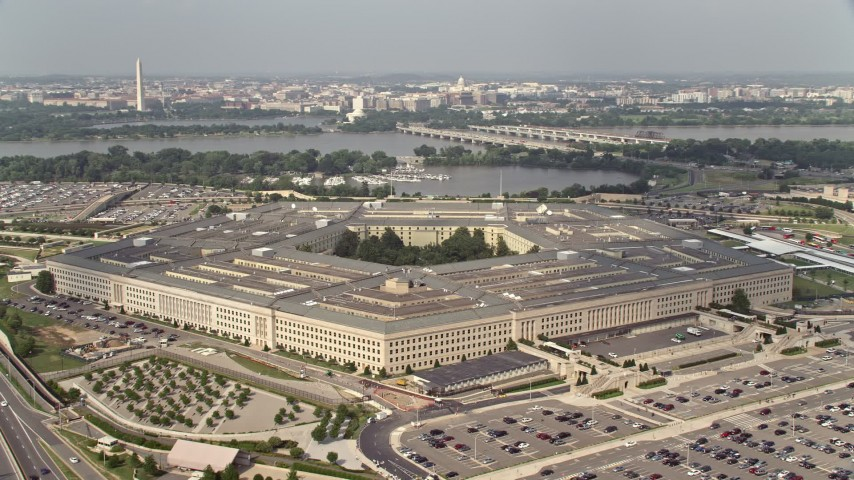 5K stock footage aerial video orbiting The Pentagon in Washington DC, with bridges over the Potomac in the background Aerial Stock Footage | AX75_128E