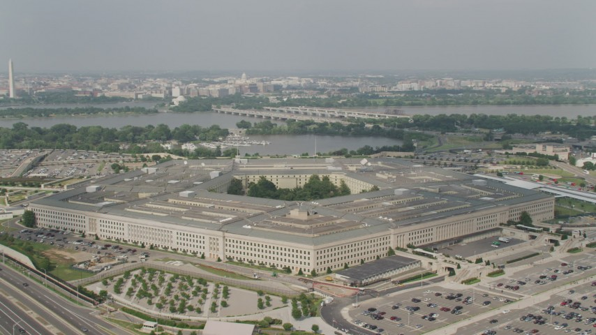 5K aerial video orbiting The Pentagon in Washington DC, with Washington Monument and Potomac in the background Aerial Stock Footage | AX75_129