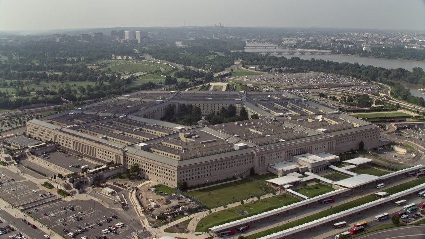 5K stock footage aerial video orbiting The Pentagon in Washington DC with Potomac River in the background Aerial Stock Footage | AX75_130E