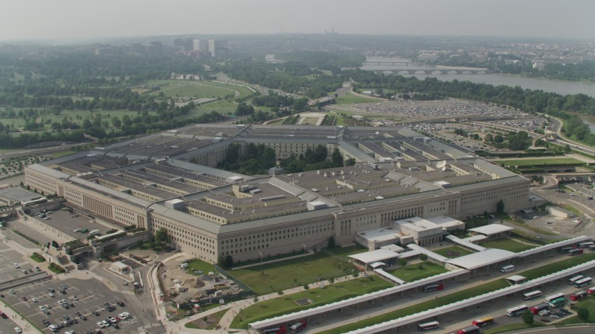 5K stock footage aerial video orbiting The Pentagon in Washington DC, with Arlington National Cemetery in the background Aerial Stock Footage | AX75_131