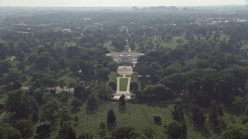 5K aerial video approaching, flying over the Tomb of the Unknown Soldier at Arlington National Cemetery in Washington DC Aerial Stock Footage | AX75_137
