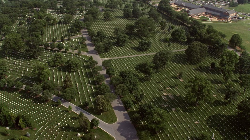 5K aerial video of rows of graves at Arlington National Cemetery in Washington DC Aerial Stock Footage AX75_138