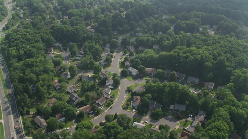 5K aerial video of a bird's eye view of suburban homes near Lake Royal in Fairfax, Virginia Aerial Stock Footage | AX75_159