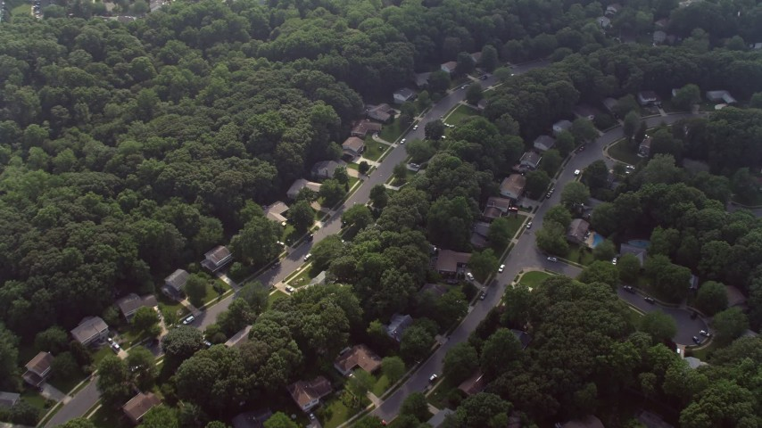 5K aerial video tilting to bird's eye view of rows of suburban homes in Fairfax, Virginia Aerial Stock Footage | AX75_161