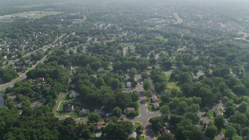5K stock footage aerial video flying over a suburban residential neighborhood in Manassas, Virginia Aerial Stock Footage | AX75_172