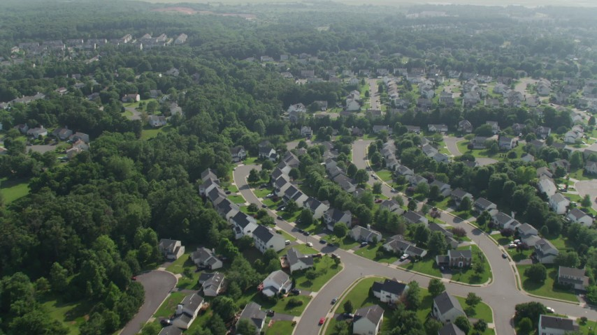 5K stock footage aerial video flying over waterfront row houses and homes by a small pond in Manassas, Virginia Aerial Stock Footage | AX75_174