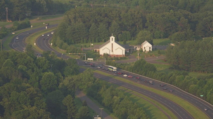 5K stock footage aerial video of Buckhall United Methodist Church, busy intersections, Manassas, Virginia, sunset Aerial Stock Footage | AX76_004