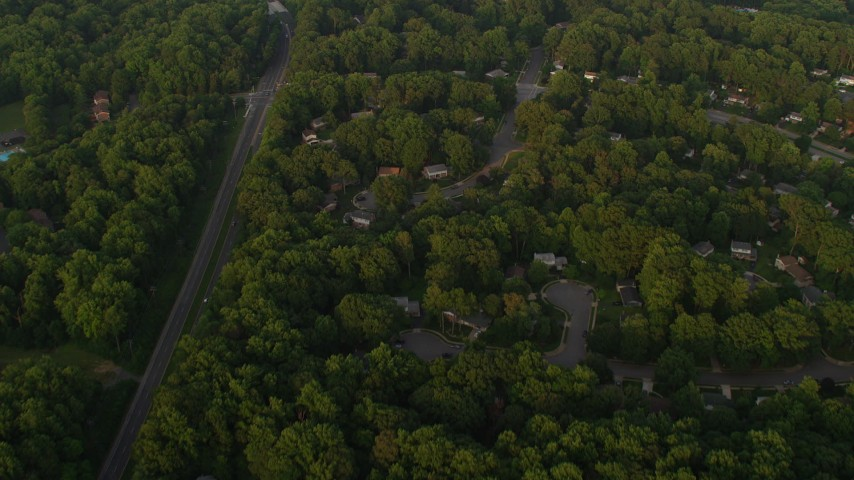 5K stock footage aerial video of a bird's eye view of tree-lined suburbs, Springfield, Virginia, sunset Aerial Stock Footage | AX76_018