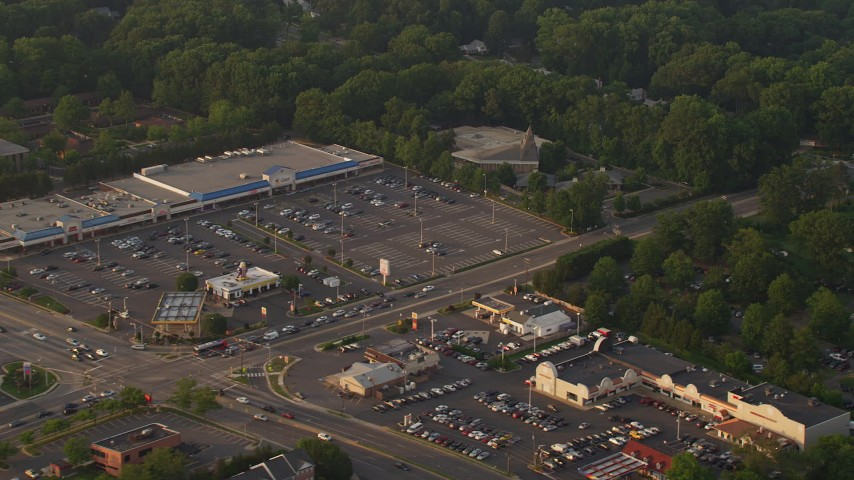 5K aerial video of Prince of Peace Lutheran Church, strip mall, suburban houses in Springfield, Virginia, sunset Aerial Stock Footage   AX76_020