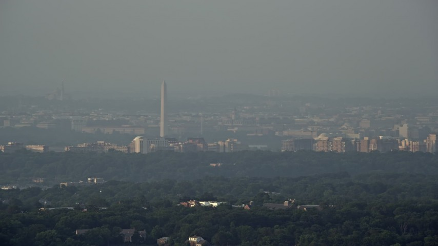 5K stock footage aerial video of Washington Monument, hazy, Alexandria, Virginia, Washington, D.C., Sunset Aerial Stock Footage | AX76_025