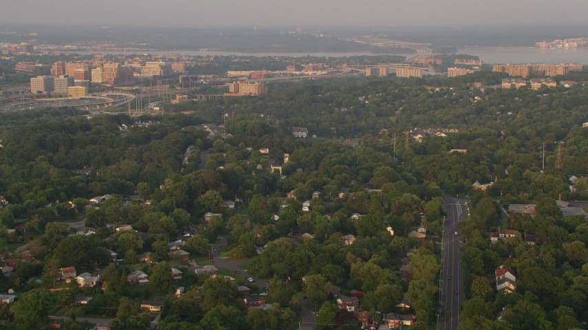 5K aerial video flying over neighborhood, approach row houses, Alexandria, Virginia, sunset Aerial Stock Footage | AX76_027