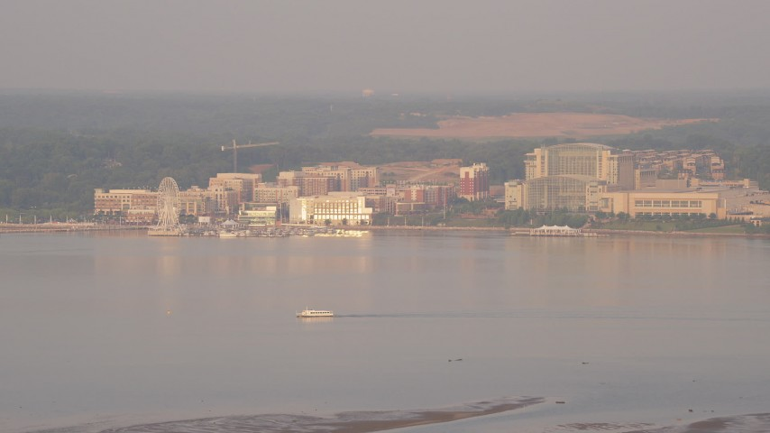 5K stock footage aerial video of the Capitol Wheel, apartment buildings beside the Gaylord National Resort & Convention Center, National Harbor, Maryland, sunset Aerial Stock Footage | AX76_029
