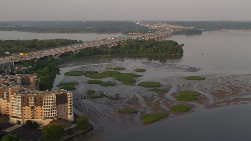 5K aerial video of Woodrow Wilson Memorial Bridge, Potomac River, Fort Washington, Maryland, sunset Aerial Stock Footage   AX76_031