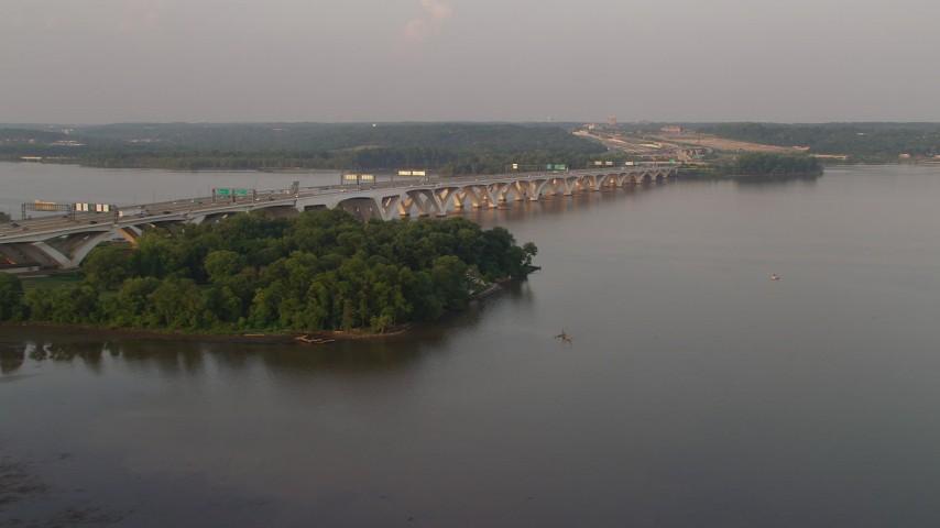 5K stock footage aerial video of Woodrow Wilson Memorial Bridge, Potomac River, Fort Washington, Maryland, sunset Aerial Stock Footage   AX76_031