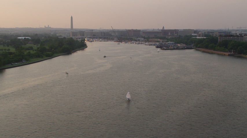 5K stock footage aerial video approaching sailboats, piers on Washington Channel near Washington Monument, Washington D.C., sunset Aerial Stock Footage | AX76_041