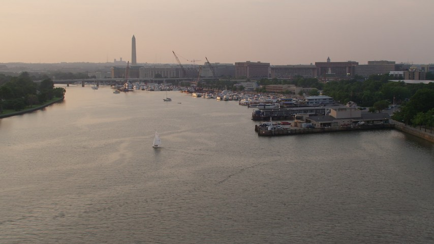 5K stock footage aerial video approaching piers, Gangplank Marina on Washington Channel near Washington Monument, Washington D.C., sunset Aerial Stock Footage | AX76_042