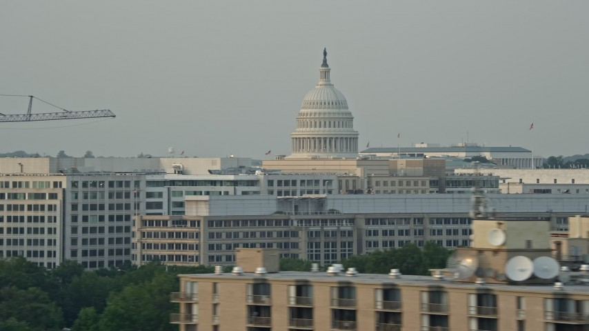 5K stock footage aerial video flying by United States Capitol dome, Washington D.C., sunset Aerial Stock Footage   AX76_042E