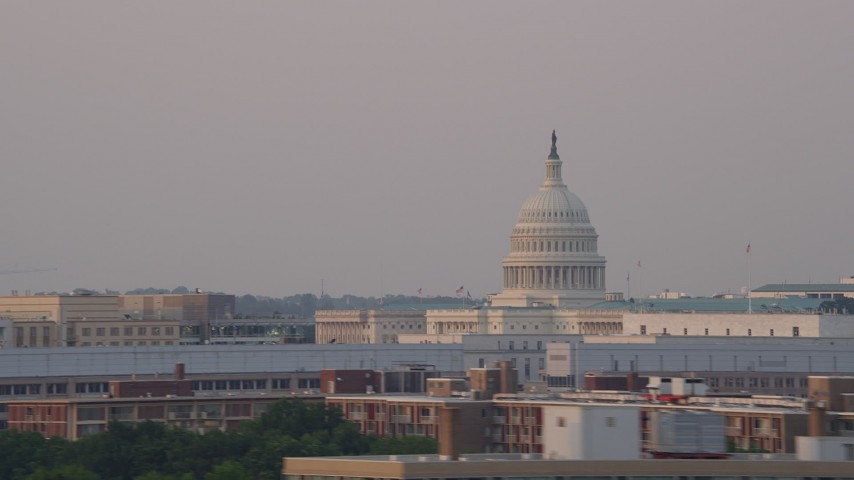 5K stock footage aerial video flying by United States Capitol dome, Washington D.C., sunset Aerial Stock Footage | AX76_043