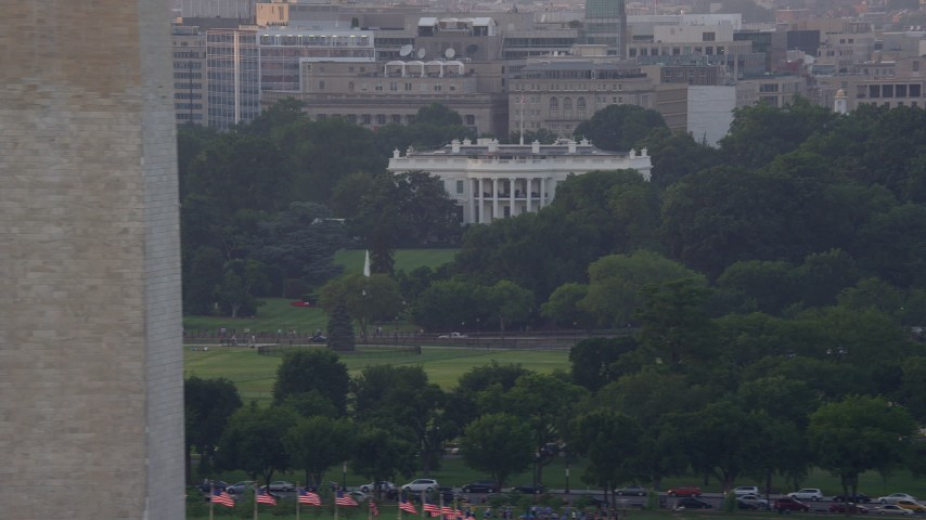 5K stock footage aerial video flying by The White House and Washington Monument, Washington D.C., sunset Aerial Stock Footage | AX76_047