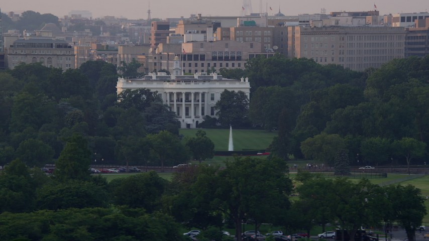 5K aerial video flying by The White House, Washington D.C., sunset Aerial Stock Footage | AX76_048