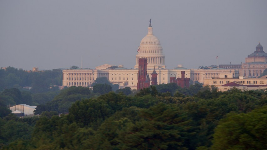 5K stock footage aerial video of the United States Capitol, Smithsonian Castle, Sidney Yates Building, Washington D.C., sunset Aerial Stock Footage | AX76_058