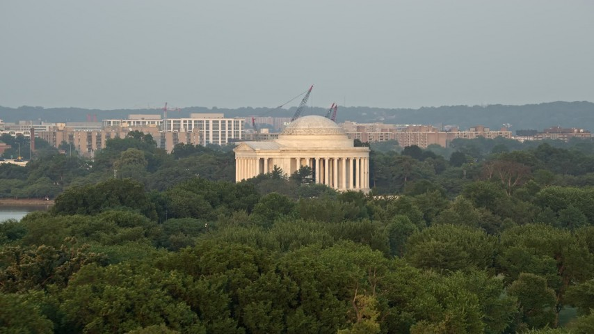 5K stock footage aerial video approaching the Jefferson Memorial with tourists, Washington D.C., sunset Aerial Stock Footage | AX76_059