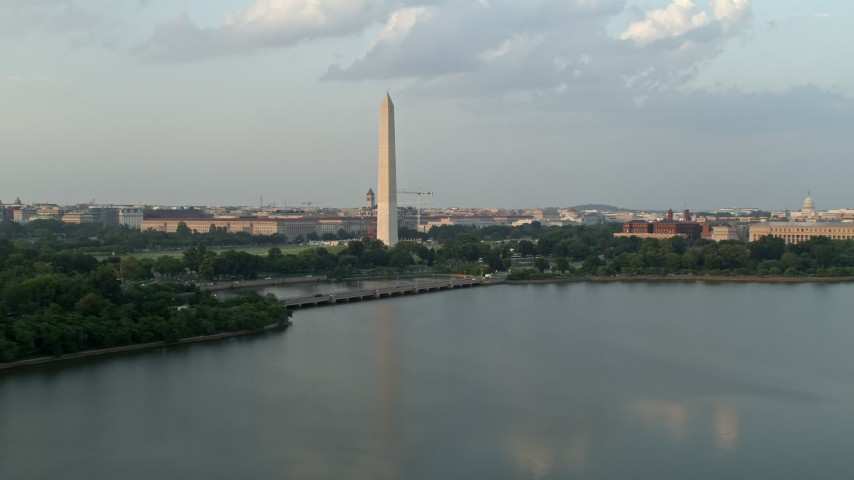 5K aerial video of Washington Monument seen from Tidal Basin, Washington D.C., sunset Aerial Stock Footage | AX76_060