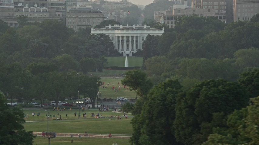 5K stock footage aerial video flying by The White House, Washington D.C., sunset Aerial Stock Footage | AX76_062