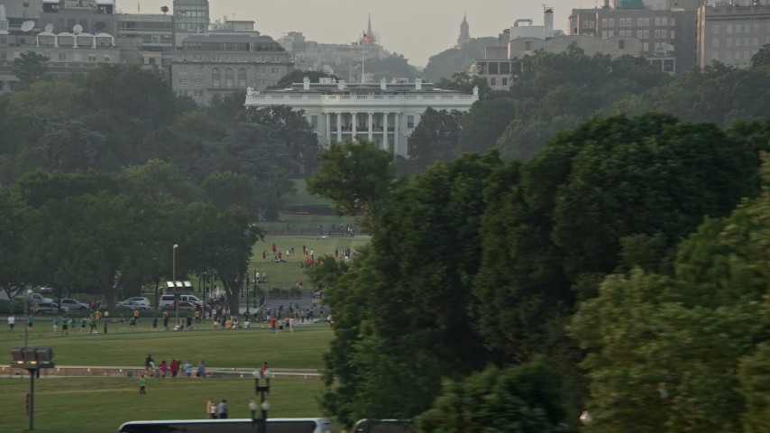 5K stock footage aerial video flying by The White House, Washington D.C., sunset Aerial Stock Footage | AX76_063