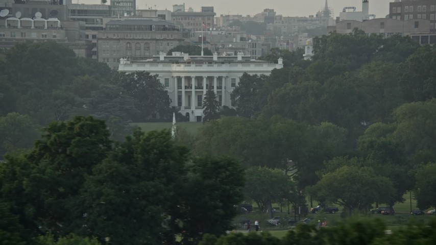 5K stock footage aerial video flying by The White House and the South Lawn Fountain, Washington D.C., sunset Aerial Stock Footage | AX76_066