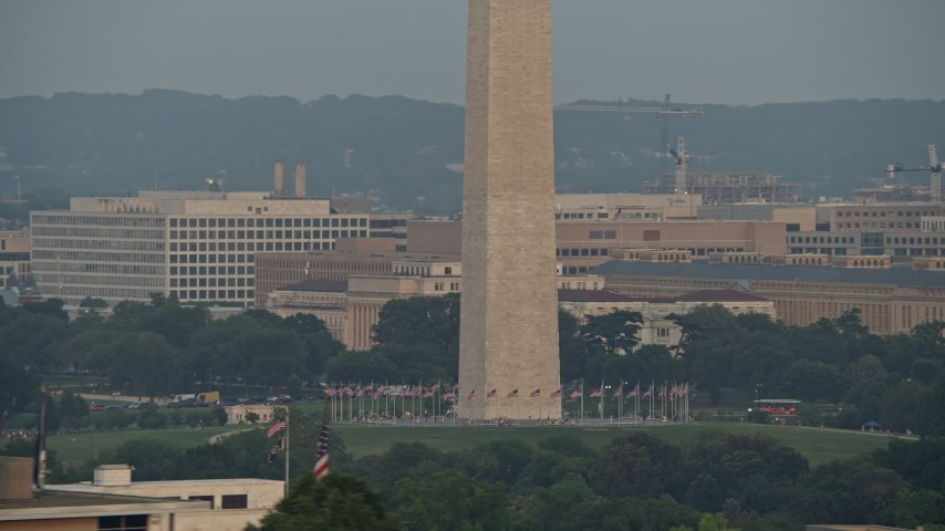 5K stock footage aerial video he base of Washington Monument in the National Mall, Washington D.C., sunset Aerial Stock Footage | AX76_072