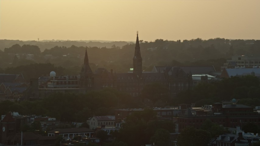 5K aerial video flying by Georgetown University, Washington D.C., sunset Aerial Stock Footage | AX76_073