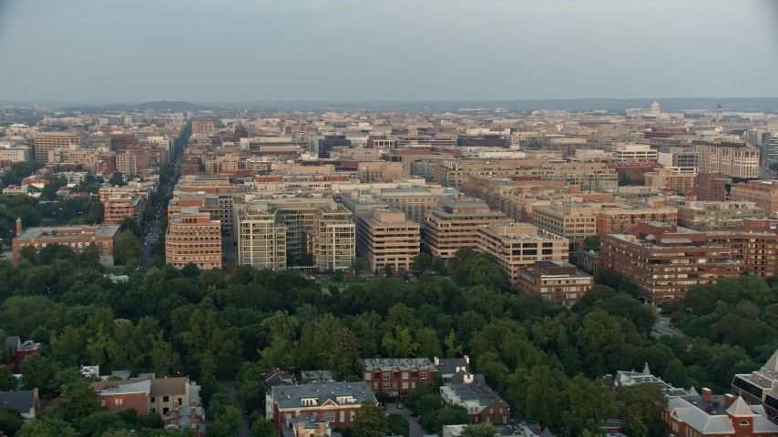 5K stock footage aerial video of apartment and office buildings, Washington D.C., sunset Aerial Stock Footage | AX76_074