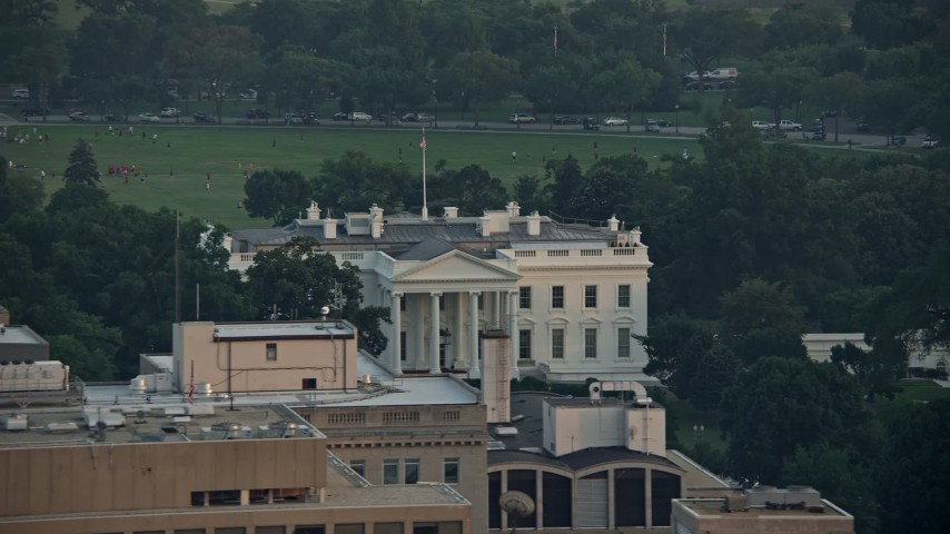 5K stock footage aerial video flying by The White House, reveal North Lawn Fountain, Washington D.C., sunset Aerial Stock Footage AX76_077 | Axiom Images