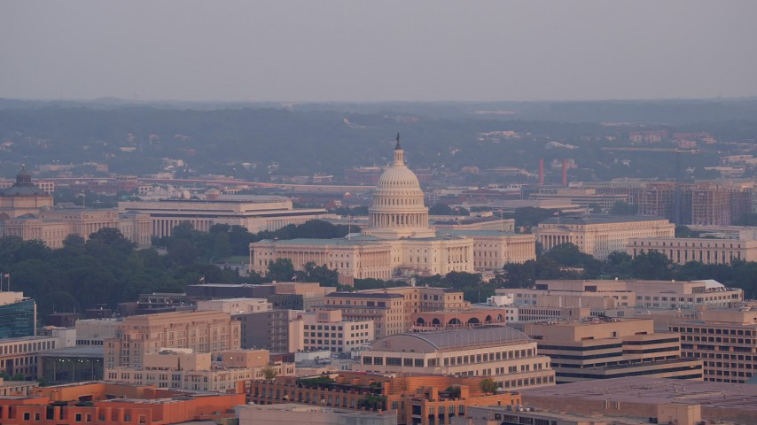 5K stock footage aerial video flying by the United States Capitol, Washington D.C., sunset Aerial Stock Footage | AX76_080