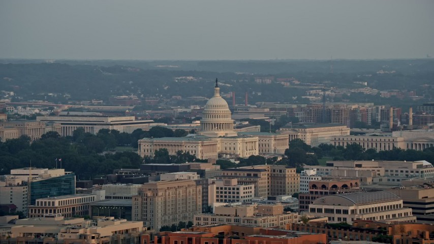 5K stock footage aerial video flying by the United States Capitol, Washington D.C., sunset Aerial Stock Footage | AX76_080E