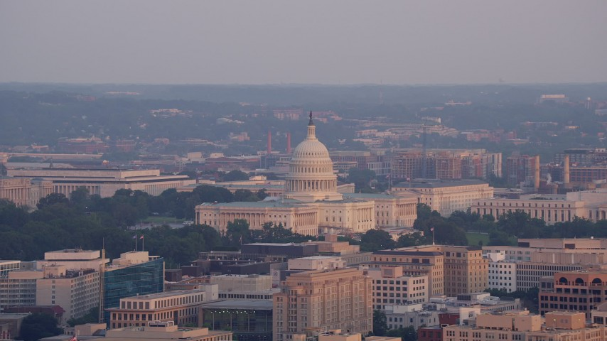 5K aerial video flying by United States Capitol, Washington D.C., sunset Aerial Stock Footage | AX76_081