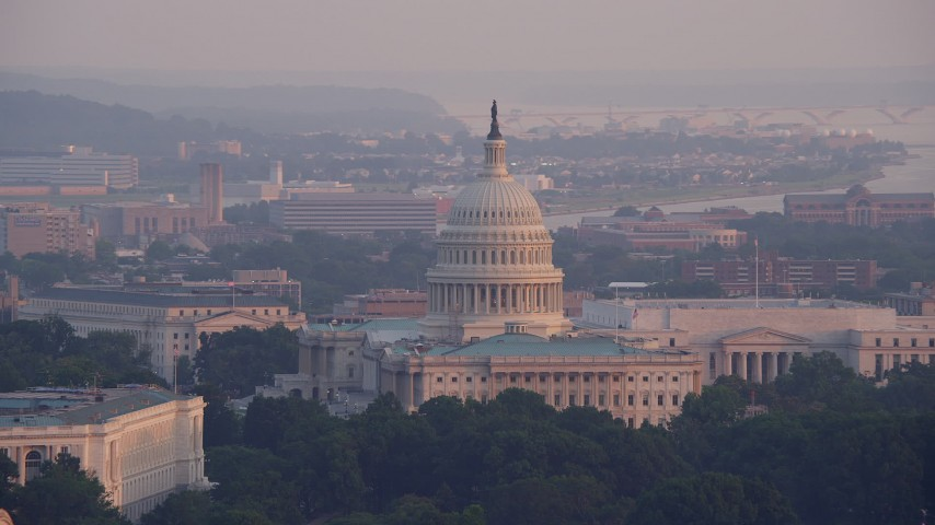5K stock footage aerial video of the United States Capitol and the Rayburn Office Building in Washington D.C., sunset Aerial Stock Footage | AX76_084