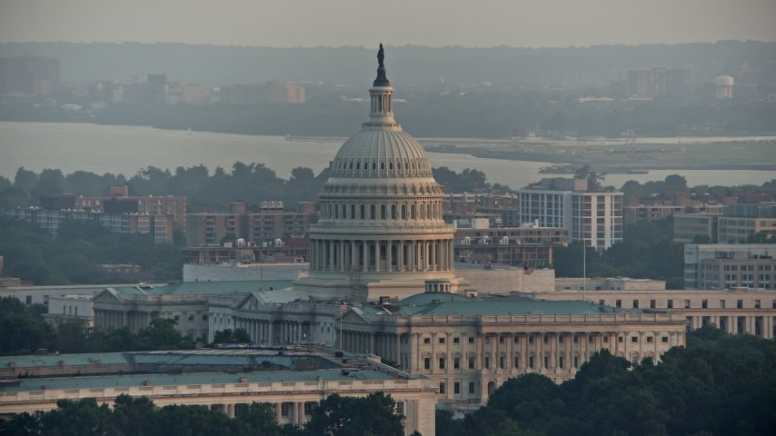 5K stock footage aerial video of the dome of the United States Capitol, Washington D.C., sunset Aerial Stock Footage | AX76_085