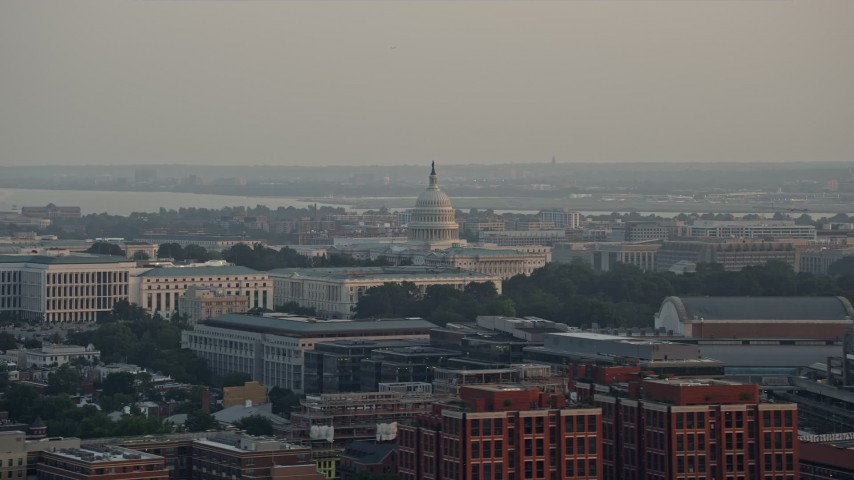 5K aerial video of the United States Capitol behind the Russell Senate Office Building, Washington D.C., sunset Aerial Stock Footage | AX76_086