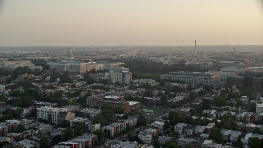 5K stock footage aerial video of the Supreme Court, United States Capitol, Senate Buildings, Washington Monument in Washington D.C., sunset Aerial Stock Footage | AX76_088