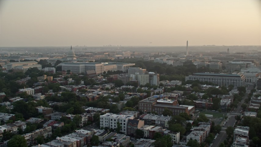 5K stock footage aerial video of the Supreme Court, United States Capitol, Senate Buildings, Washington Monument in Washington D.C., sunset Aerial Stock Footage   AX76_088